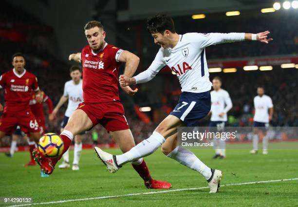 HeungMinSon of Tottenham Hotspur shoots past Jordan Henderson of Liverpool during the Premier League match between Liverpool and Tottenham Hotspur at...