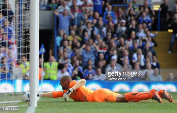 Heurelho Gomes of Spurs can't stop Frank Lampard of Chelsea's opening goal from crossing the line during the Barclays Premier League match between...