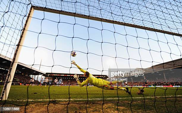 Heurelho Gomes of Tottenham Hotspur fails to stop Danny Murphy of Fulham scoring their first goal from the penalty spot during the FA Cup sponsored...