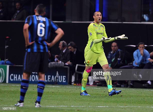 Heurelho Gomes of Tottenham Hotspur reacts after being sent off during the UEFA Champions League Group A match between FC Internazionale Milano and...