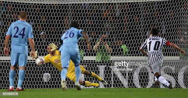 Heurelho Gomes of Tottenham is unable to stop the penalty from Antonio Di Natale of Udinese during the UEFA Cup Group D match between Udinese and...