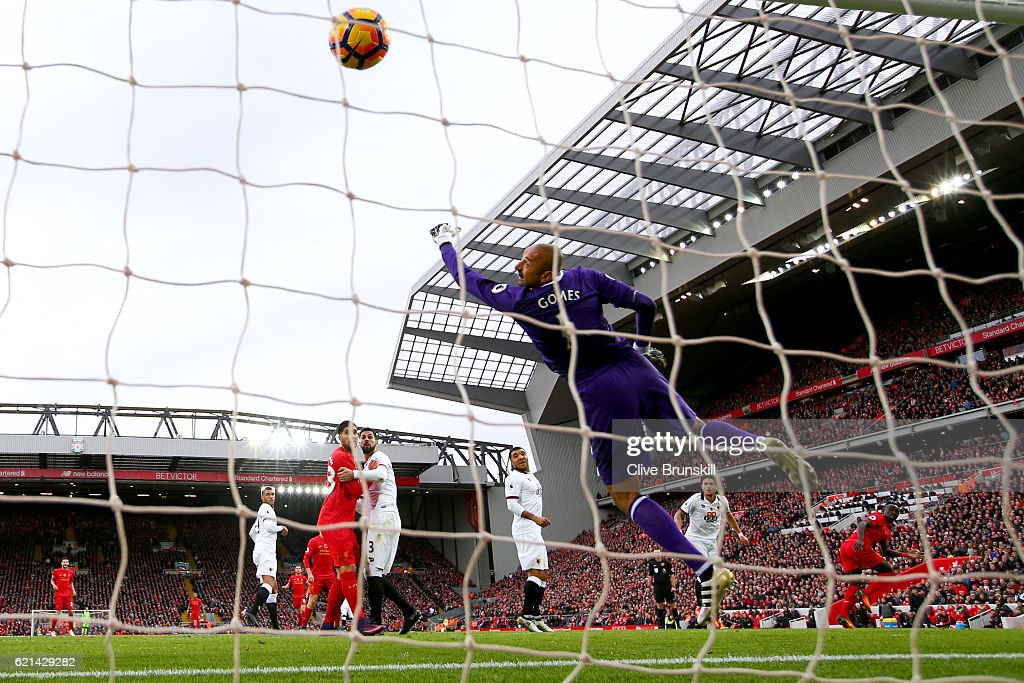 Heurelho Gomes of Watford attempts to save as Sadio Mane of Liverpool scores his sides first goal during the Premier League match between Liverpool and Watford at Anfield on November 6, 2016 in Liverpool, England.