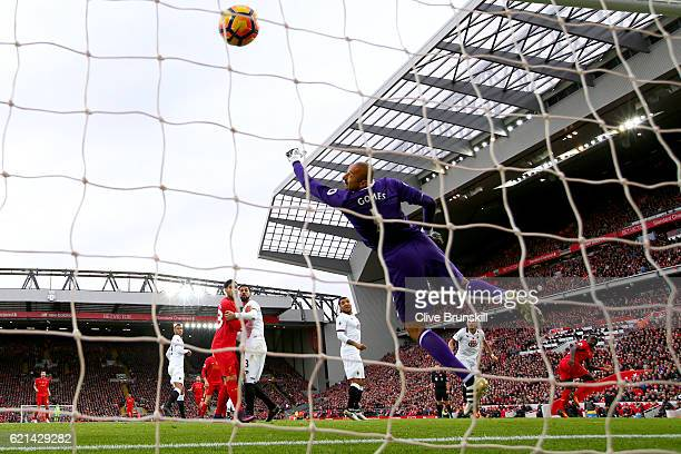 Heurelho Gomes of Watford attempts to save as Sadio Mane of Liverpool scores his sides first goal during the Premier League match between Liverpool...