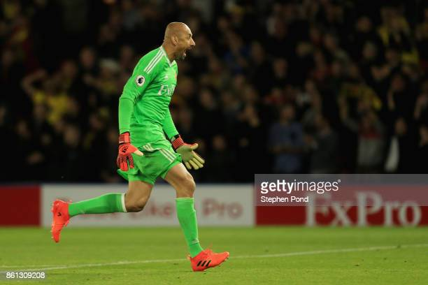 Heurelho Gomes of Watford celebrates as Troy Deeney of Watford scores their first and equalising goal from the penalty spot during the Premier League...
