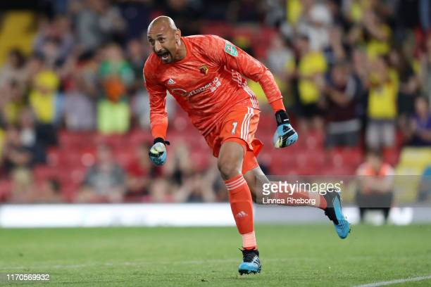 Heurelho Gomes of Watford celebrates his team's second goal scored by team mate Daryl Janmaat during the Carabao Cup Second Round match between...