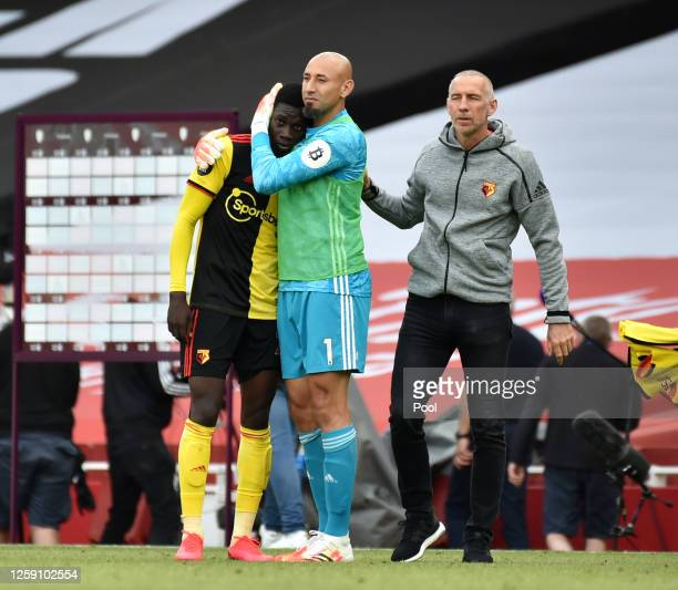 Heurelho Gomes of Watford consoles Ismaila Sarr of Watford after their side are relegated after the Premier League match between Arsenal FC and...