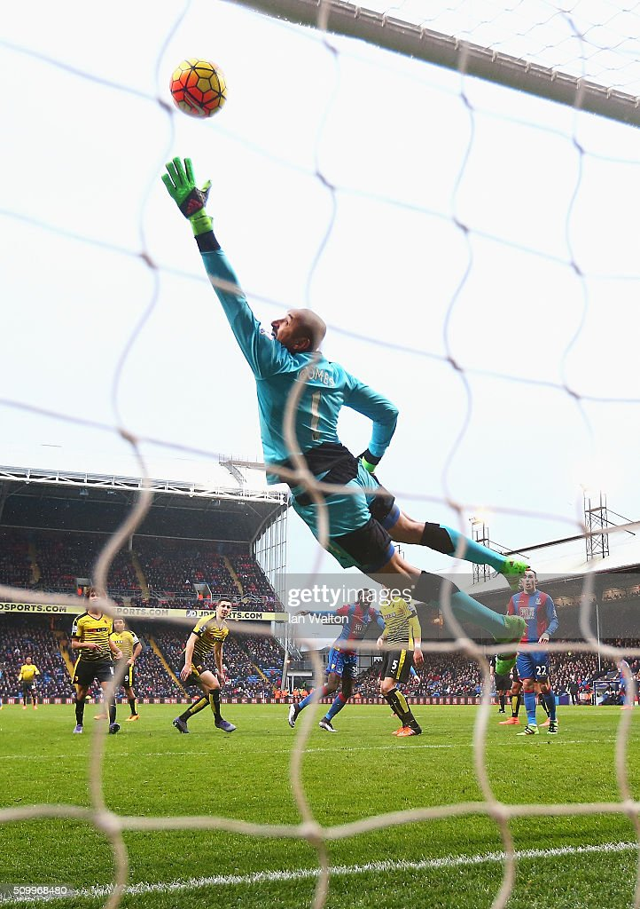 Heurelho Gomes of Watford dives in vain as Emmanuel Adebayor (4th L) of Crystal Palace scores his team's first goal during the Barclays Premier League match between Crystal Palace and Watford at Selhurst Park on February 13, 2016 in London, England.
