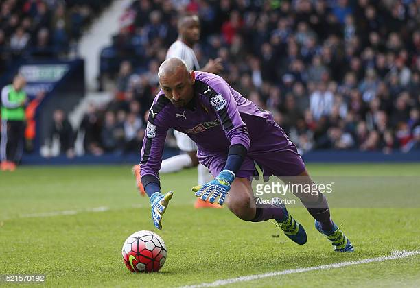 Heurelho Gomes of Watford dives on the ball after saving a second penalty by Saido Berahino of West Bromwich Albion during the Barclays Premier...