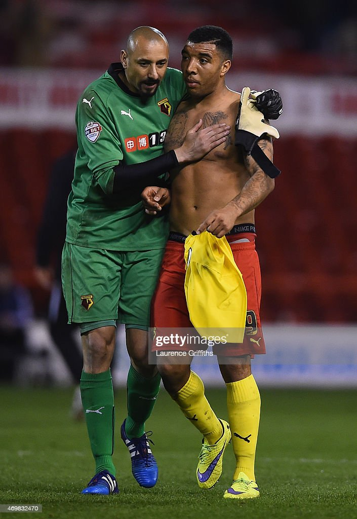 Heurelho Gomes of Watford hugs Troy Deeney of Watford after the Sky Bet Championship match between Nottingham Forest and Watford at City Ground on April 15, 2015 in Nottingham, England.
