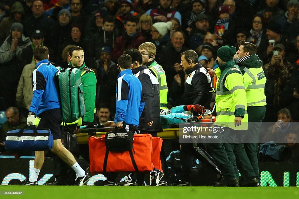 Heurelho Gomes of Watford is taken off by a stretcher after injury during the Barclays Premier League match between Aston Villa and Watford at Villa Park on November 28, 2015 in Birmingham, England.