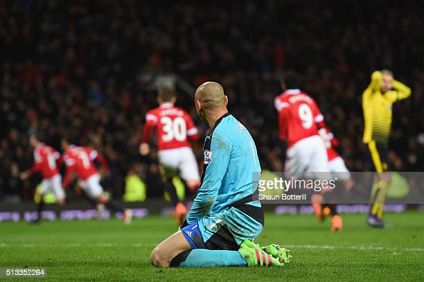 Heurelho Gomes of Watford looks dejected as Juan Mata of Manchester United scores their first goal dduring the Barclays Premier League match between...