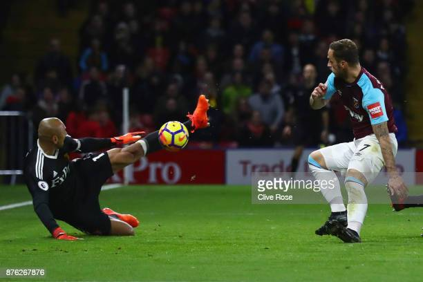 Heurelho Gomes of Watford makes a save from Marko Arnautovic of West Ham United during the Premier League match between Watford and West Ham United...