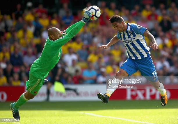 Heurelho Gomes of Watford punches the ball before Anthony Knockaert of Brighton and Hove Albion can get his head to the ball during the Premier...