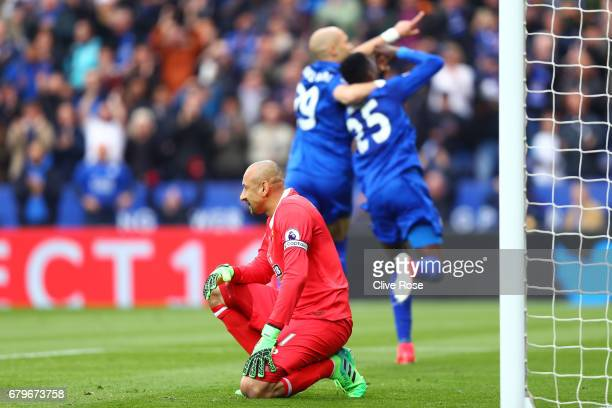 Heurelho Gomes of Watford reacts to Leicester City scoring their first goal during the Premier League match between Leicester City and Watford at The...