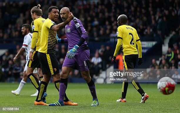 Heurelho Gomes of Watford reacts with Troy Deeney after he saved the penalty by Saido Berahino of West Bromwich Albion during the Barclays Premier...