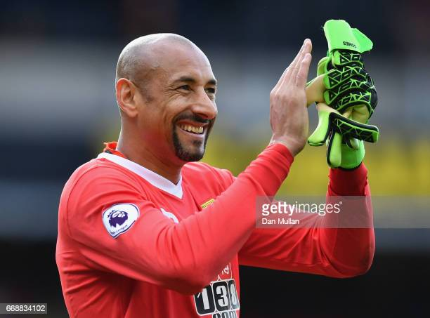 Heurelho Gomes of Watford shows appreciation to the fans after the Premier League match between Watford and Swansea City at Vicarage Road on April 15...