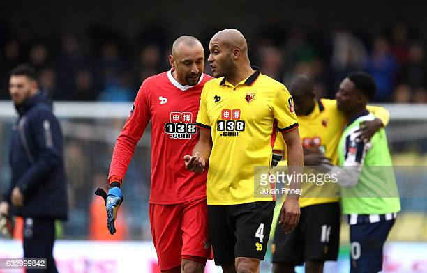 Heurelho Gomes of Watford speaks to Younes Kaboul of Watford after The Emirates FA Cup Fourth Round match between Millwall and Watford at The Den on...