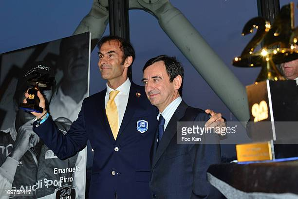 Heures Du Mans driver Emmanuel Pirro and Pierre Fillon attend the '24 heures Du Mans' 90th Anniversary At Le Georges on May 31 2013 in Paris France