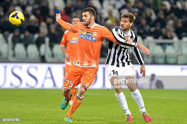 Heurtaux and Llorente during the Serie A match between Juventus and Udinese at Juventus Stadium on December 1 2013 in Torino Italy Photo Filippo...
