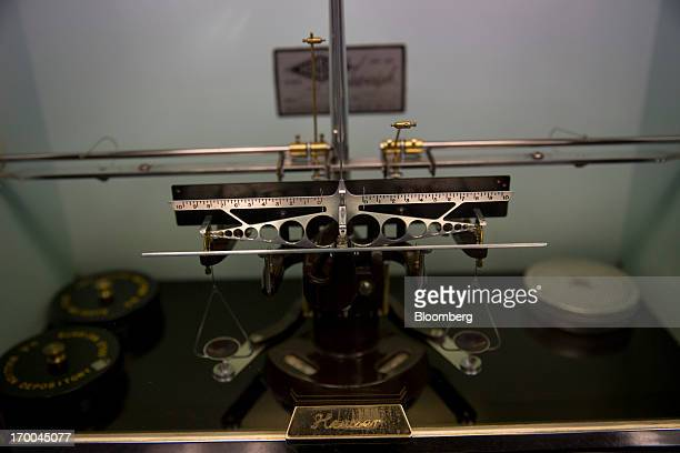 A Heusser scale used for weighing gold sits on a laboratory counter at the United States Mint at West Point in West Point New York US on Wednesday...