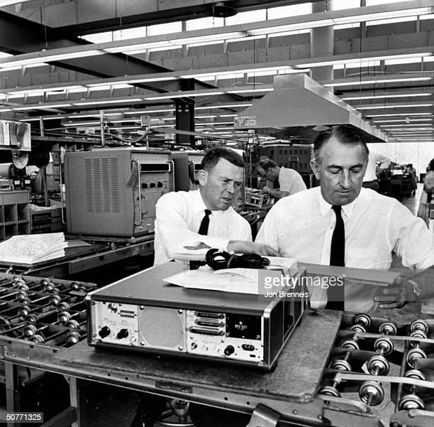 Hewlett Packard founders William Hewlett David Packard w transistorized electronic counters in factory