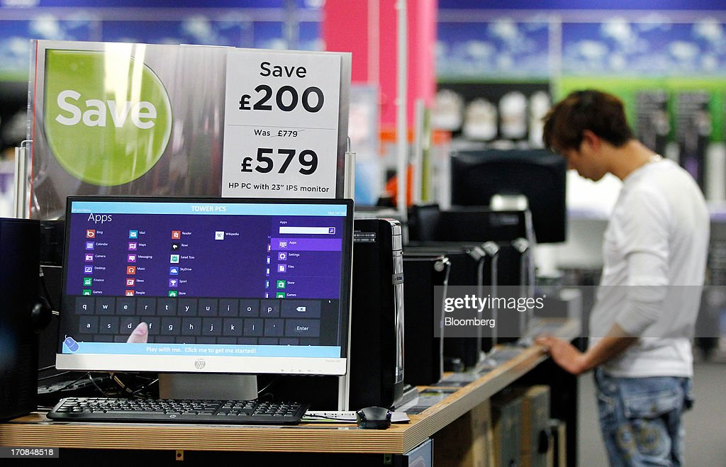 A Hewlett-Packard Co. IPS (in-plane switching) monitor and desktop computer sits displayed for sale inside a Currys and PC World 2 in 1 store, operated by Dixons Retail Plc, in Manchester, U.K., on Tuesday, June 18, 2013. Dixons Retail Plc, the U.K.'s largest consumer-electronics retailer, said last month it will report annual pretax profit at the 'top end' of analysts' predictions after fourth-quarter revenue beat estimates on increased sales of tablets and services such as software tutorials. Photographer: Paul Thomas/Bloomberg via Getty Images