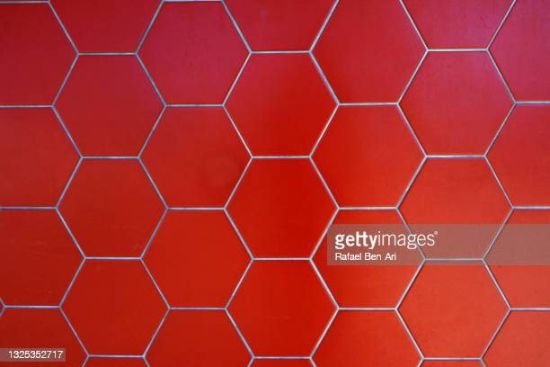 hexagon shape pattern of  a tiled wall - rafael ben ari stock pictures, royalty-free photos & images