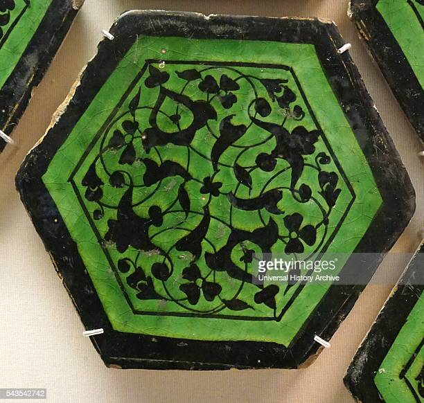 Hexagonal tiles painted with black cruciform arabesque scrolls and blossoms From Iran Dated 15th Century