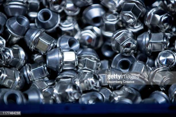 hexagonal wheel nuts - fastening stock pictures, royalty-free photos & images