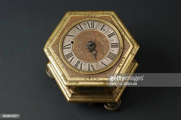 Hexagonalshaped horizontal table clock inserted in a glass and brass case hour and minute hands signed Christoff Muller Augusta Germany late...