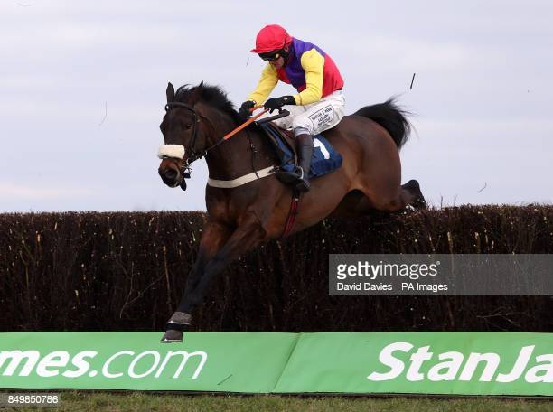 Hey Big Spender ridden by Joe Tizzard clears a fence during the Barbury International Supporting Greatwood Veterans' Handicap Steeple Chase
