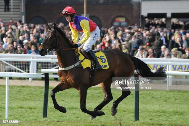 Hey Big Spender ridden by Joe Tizzard goes to post for the Ryanair Chase on St Patrick's Day during the Cheltenham Festival