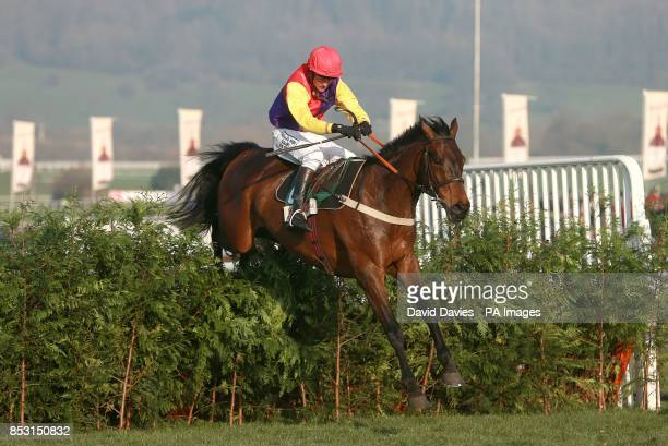 Hey Big Spender ridden by Joe Tizzard in action in the Glenfarclas Handicap Chase on Ladies Day during the Cheltenham Festival