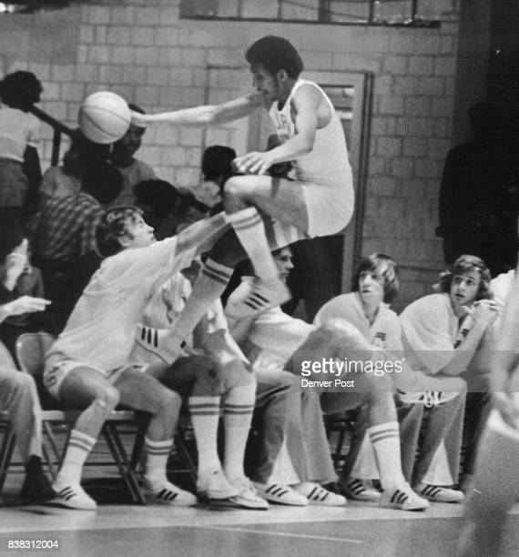 MAR 2 1974 MAR 3 1974 'Hey Guys I Think I'm Running Out of Runway' Tony Lawrence of Colorado chases a loose ball out of bounds at the Buff bench...