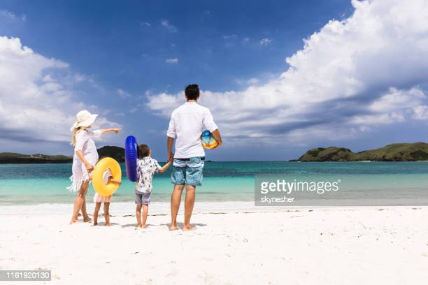 hey guys, let's go to that part of the beach! - family beach holiday stock pictures, royalty-free photos & images