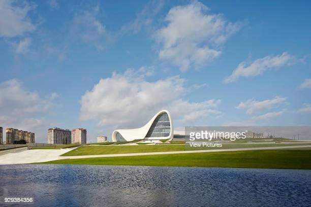 Heydar Alijev Cultural Centre, Baku, Azerbaijan. Architect: Zaha Hadid Architects, 2013. View across landscaped pond towards centre.