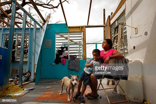 Heydee Perez age 29 and her son Yenel Calera age 4 have not received any aid one week after Hurricane Maria The roof of their home is gone and they...