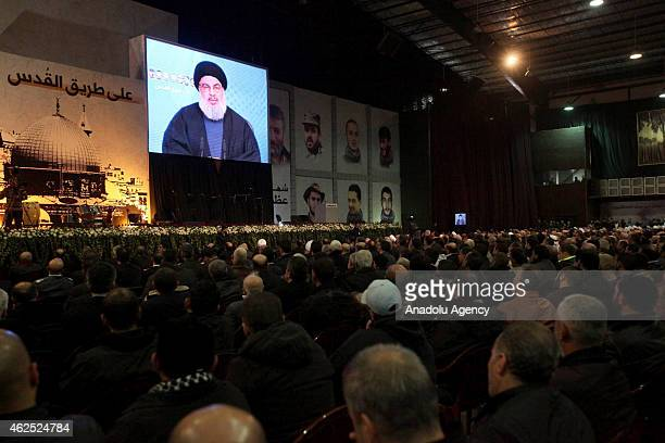 Hezbollah chief Hassan Nasrallah speaks via video conference during the commemoration ceremony for killed militants of Hezbollah in Syria, on January...