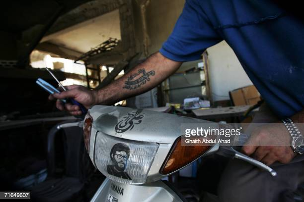 Hezbollah fighter handles his scooter, with an image of Hezbollah leader Sheikh Hassan Nasrallah on it, several kilometers away from the Lebanese...