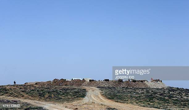 Hezbollah fighters monitor the countryside of Arsal from their post in Dahr alHawa hill on the Lebanese side of the Qalamun mountains on the border...
