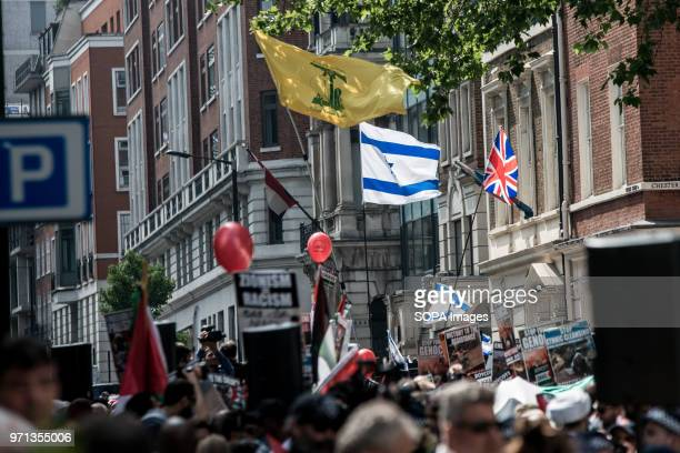 Hezbollah flag in front the prozionist counterdemo Hundreds of antiIsrael protesters marched through the streets on the annual Al Quds Day Started by...