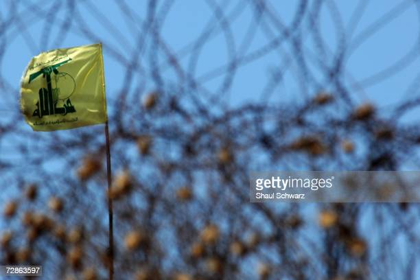 Hezbollah flag still stands just meters into Lebanon July 21 2006 Israeli soldiers started crossing the border today in higher numbers than in past...