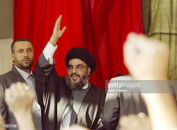 Hezbollah leader Sayyed Hassan Nasrallah waves during his speech at a rally September 22, 2006 in Beirut, Lebanon. According to reports, Nasrallah...