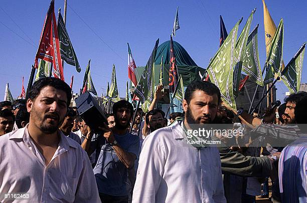 Hezbollah militants and supporters march through the Ouzai suburb of Beirut carrying religious flags on their first military parade 15th June 1986...