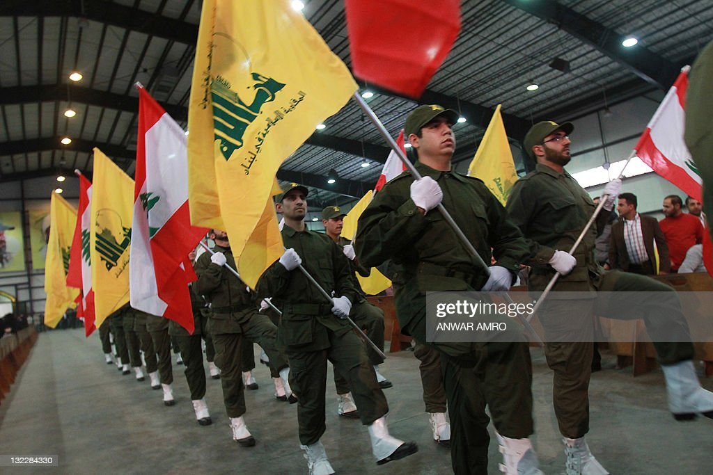 Hezbollah militants parade with the Shii : News Photo
