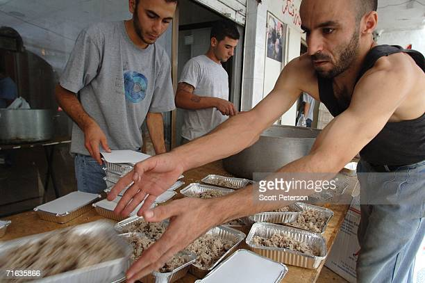 Hezbollah social services cook food for 8000 Lebanese Shiites displaced by Israeli bombardment August 12 2006 in Beirut Lebanon Some 900000 Lebanese...