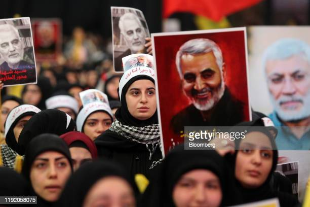 Hezbollah supporters hold pictures of Qassem Soleimani, an Iranian commander, center, and Abu Mahdi al-Muhandis, an Iraqi paramilitary chief, as...