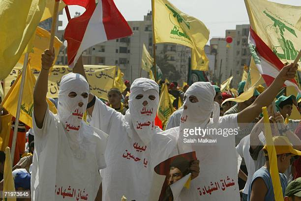 Hezbollah supporters wave flags during a ''Victory over Israel'' rally in Beirut's suburbs on September 22 2006 in Beirut Lebanon Hezbollah leader...