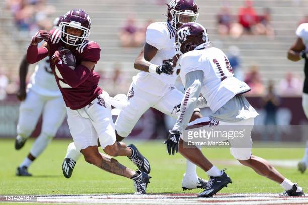 Hezekiah Jones of the Texas A&M Aggies rushes ahead of Keldrick Carper during the first half of the spring game at Kyle Field on April 24, 2021 in...