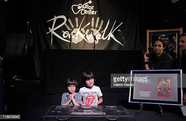 Hezron Wolfgang Farrell and Izzadore Bravo Farrell attend the induction of Jane's Addiction into Hollywood's Rockwalk at Guitar Center on Sunset Blvd...